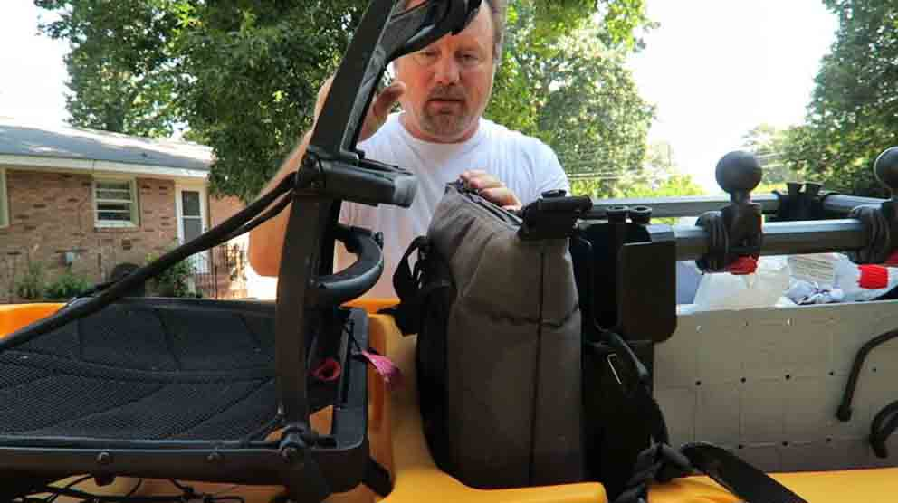 how to carry a cooler on a kayak; Behind your seat