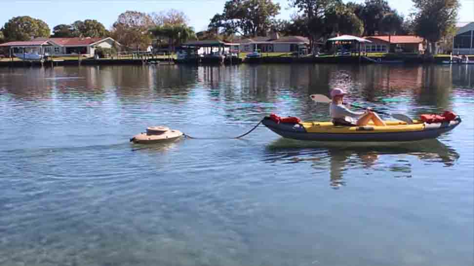 how to carry a cooler on a kayak; Using a floating cooler holder
